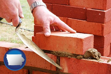 a bricklayer laying brick, building a brick wall - with Iowa icon