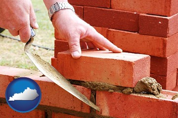 a bricklayer laying brick, building a brick wall - with Kentucky icon
