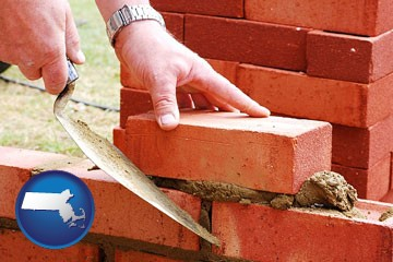 a bricklayer laying brick, building a brick wall - with Massachusetts icon