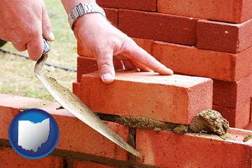 a bricklayer laying brick, building a brick wall - with Ohio icon